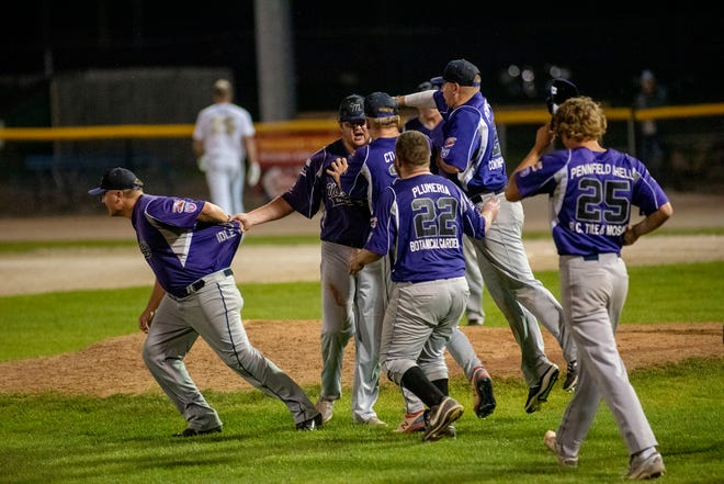 Battle Creek Merchants celebrate defeating Berea Blue Sox 6-5 on Wednesday, Aug. 4, 2021 at C.O. Brown Stadium in Battle Creek, Michigan.