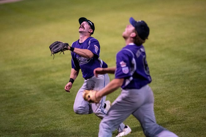 Battle Creek Merchant's Brandon Haynes (28) and  Mark Kalahar (8) attempt to catch the ball on Wednesday, Aug. 4, 2021 at C.O. Brown Stadium in Battle Creek, Michigan. The Battle Creek Merchants defeated the Berea Blue Sox 6-5.