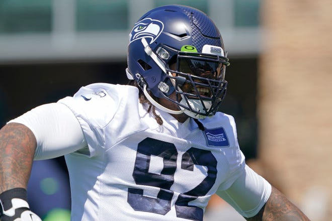 Seattle Seahawks defensive tackle Robert Nkemdiche reacts as he takes the field for NFL football practice Thursday, July 29, 2021, in Renton, Wash. (AP Photo/Ted S. Warren)