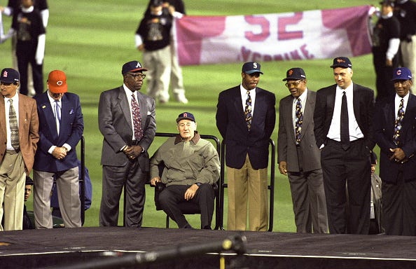 (From left) Stan Musial, Pete Rose, Hank Aaron, Ted Williams, Ken Griffey Jr., Willie Mays, Cal Ripken Jr. and Ernie Banks on stage during the All Century Team ceremony before Game 2 of the 1999 World Series between the Atlanta Braves and New York Yankees at Turner Field on Oct. 24, 1999.