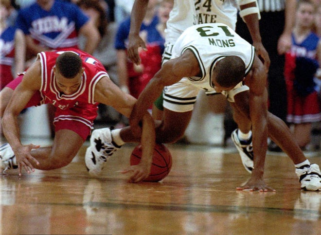 Michigan State's Eric Snow (right) and Detroit Mercy's Tony Tolbert (left) fight for a loose ball during their game at the Breslin Student Event Center in East Lansing, Mich., on Sunday, Dec. 12, 1993.