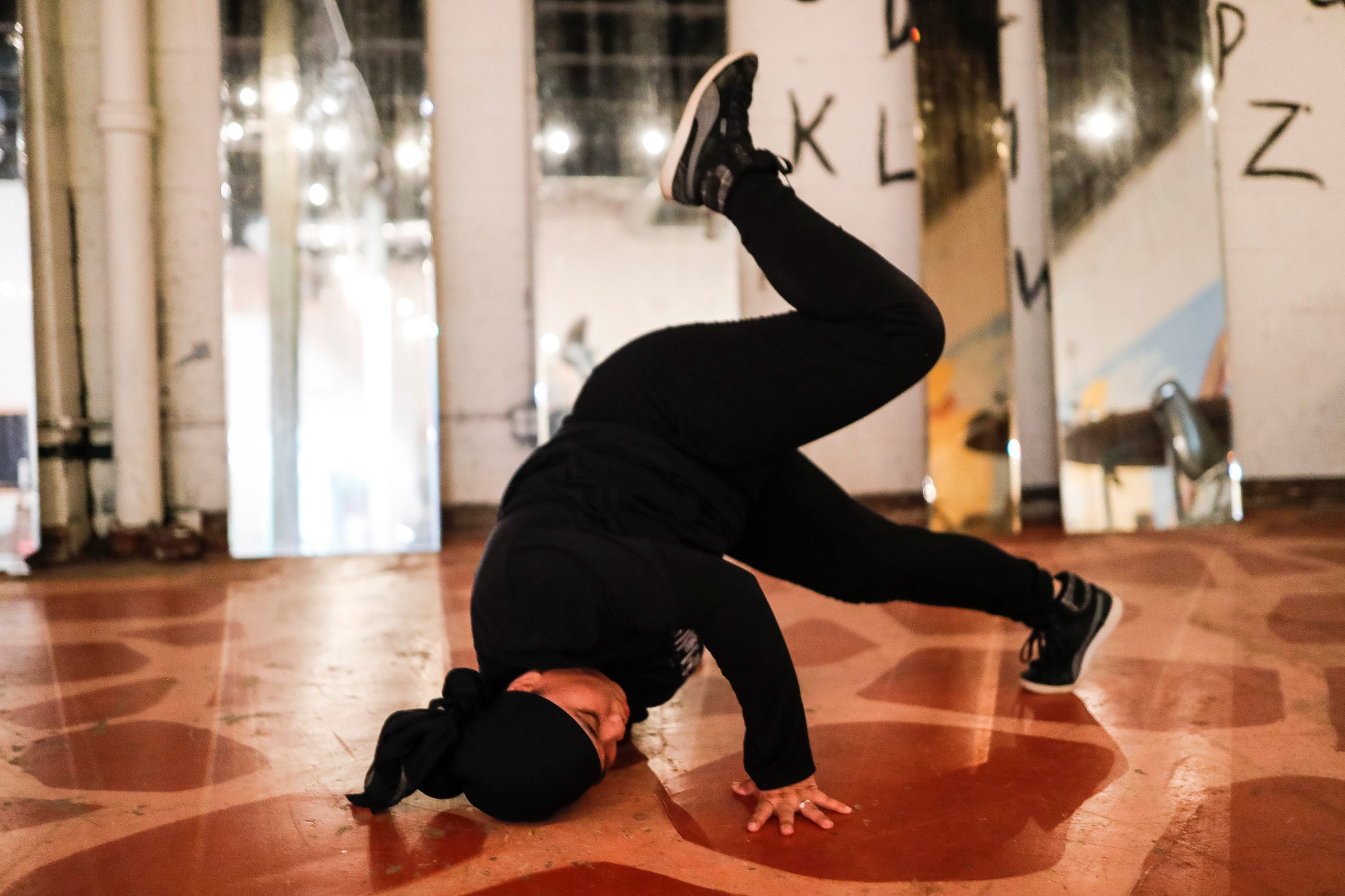 Mary Mar, also knowns as the BGIRL MAMA, practices break dance at Cass Corridor Neighborhood Development Corporation in Detroit on August 4, 2021.