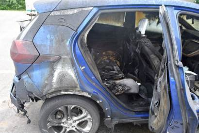 In this file image released by the Vermont State Police  taken on July 2, 2021, a 2019 Chevrolet Bolt EV is seen after it caught fire on July 1, 2021 in Thetford, Vermont.  General Motors announced July 23, 2021 a second recall of the all-electric Chevrolet Bolt to address a battery defect blamed for recent car fires.