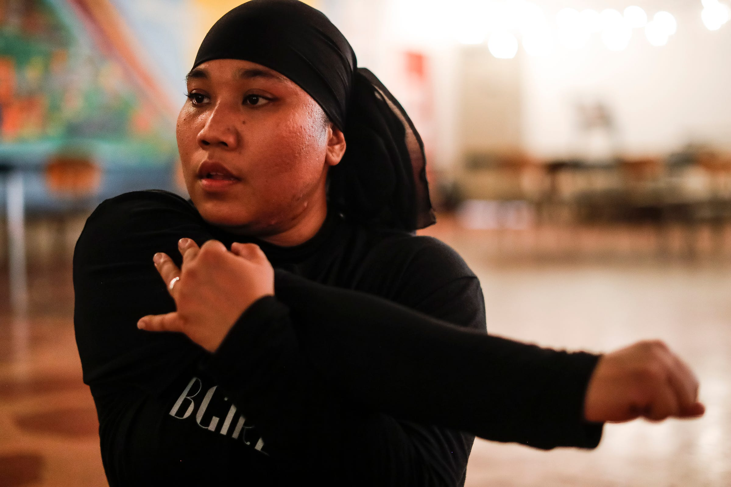 Mary Mar, also known as the BGIRL MAMA, practices break dance at Cass Corridor Neighborhood Development Corporation in Detroit on August 4, 2021.