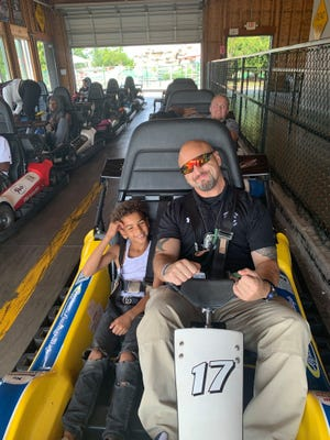 Fond du Lac Police Department School Resource Officer Jesse Pimental participates in a go-kart outing with kids from the Fond du Lac Boys & Girls Club.