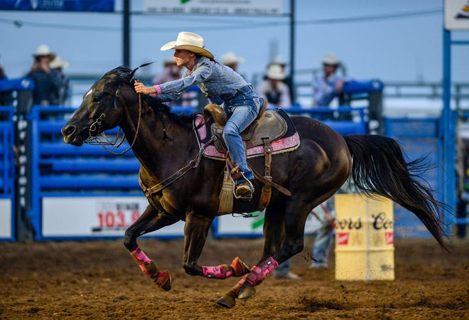 Barrel racing event at the Big Sky Pro Rodeo in Helena, Mont.