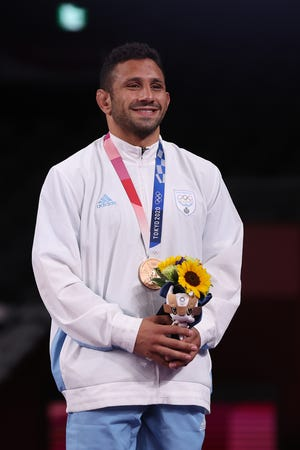 Brighton's Myles Amine, who wrestled for San Marino, is only the second Olympic medalist from Livingston County.