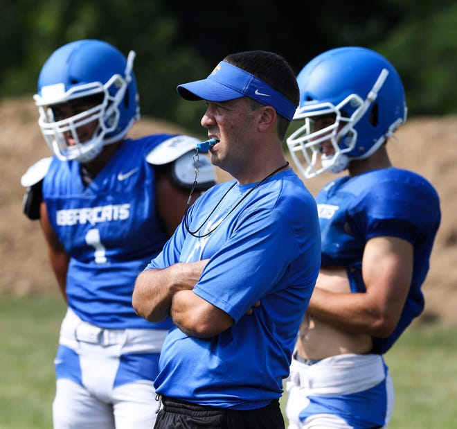 Kentucky County Day head coach Matthew Jones, center, watches practice at the school in Louisville, Ky. on Aug. 4, 2021.