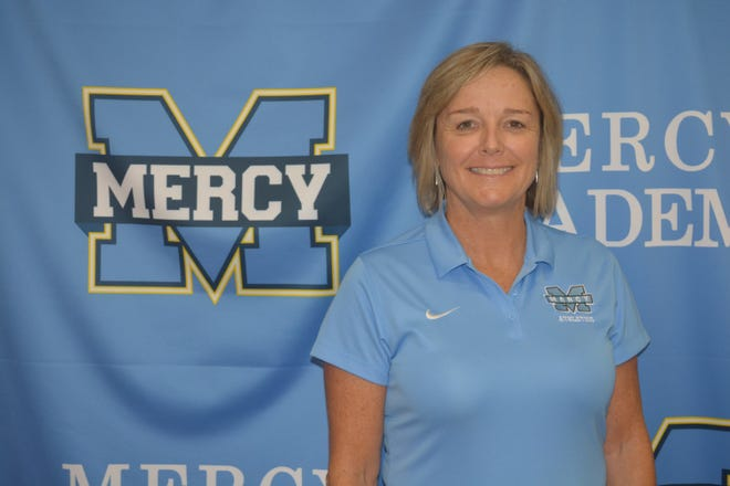 Angela Passafiume poses for a portrait shot after being announced as the new athletic director for Mercy Academy