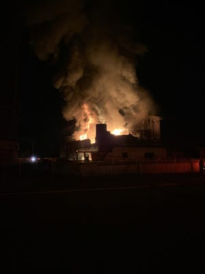 """Louisville Fire spokesman Bobby Cooper said over 50 firefighters were dispatched just after 2:30 a.m. Thursday, Aug. 5, 2021, and found """"heavy fire"""" coming from the three-story vacant warehouse by the intersection of Logan and Lampton streets."""