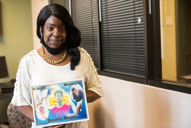 Vanessa Rogers poses with a photo of her son, Deunte' Rogers who was shot and killed in 2017 in Montgomery, Ala., on Thursday, Aug. 5, 2021.