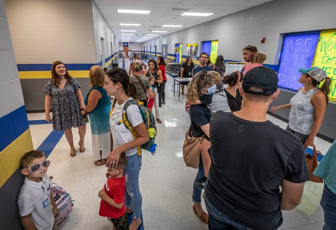 Parents and students arrive for Stoner Creek Elementary School's first day which took place in one of the wings at West Wilson Middle School due to the 2020 tornado Thursday, August 5, 2021.