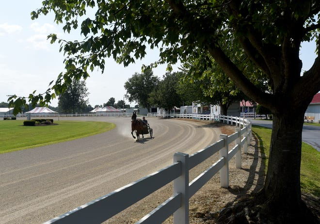 A horse and driver take a few laps around the grandstand track on Wednesday, Aug. 4, 2021 at the Hartford Fairgrounds. The Hartford Independent Fair opens Sunday, Aug. 8 for fair week.