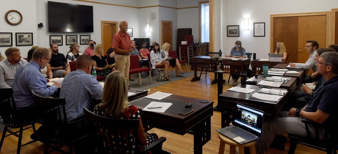 Granville resident Jurgen Pape speaks before the Granville Village Council during a public forum on a possible major land purchase to create a preserve and limit development of the Eaton Woods property on Aug. 4.