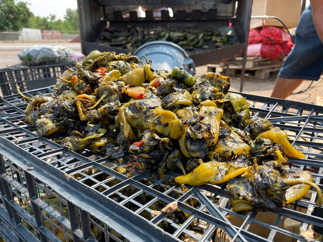 This July 12, 2021, image shows a batch of roasted green chile at a roadside stand in Hatch, New Mexico. Farmers say the season is shaping up to be a good one thanks to recent rain and cooler temperatures.
