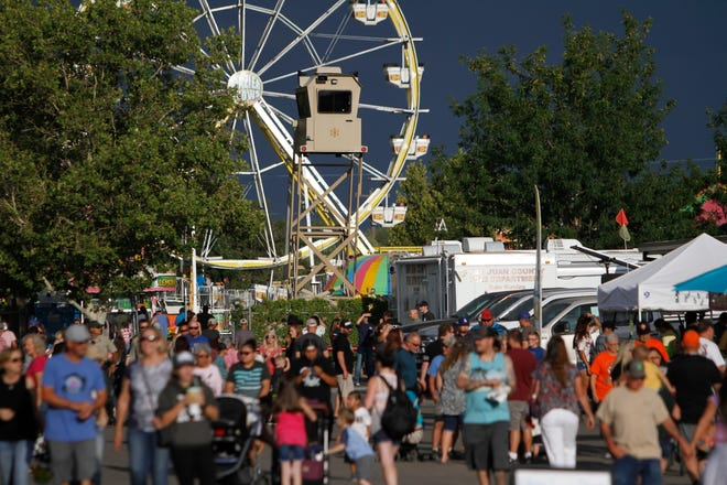 Visitors attend the San Juan County Fair, Thursday, Aug. 17, 2018 at McGee Park in Farmington.