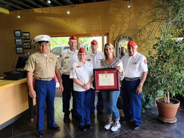Zia Detachment #850 Marine Corp. League presents a Certificate of Appreciation to Evergreen Cleaners for their continuous support of the league by providing excellent service at no charge.