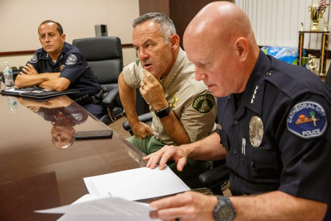 Desert Hot Springs Police Chief Jim Henson, left, Riverside County Sheriff Chad Bianco and Cathedral City Police Chief George Crum discuss the PSUSD Board of Education's decision to suspend its school resource officer program on August 5, 2021.