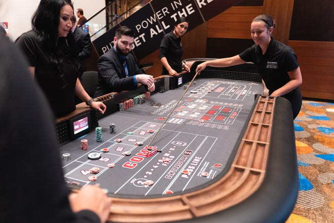 Employees prepare to open a craps table at Wild Horse Pass casino near Chandler. The property quietly launched new table games in late July.