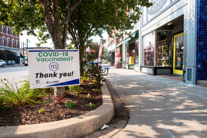 Signs thanking residents for being vaccinated are appearing in downtown Port Huron.