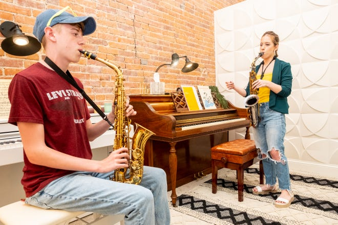 Cayla Ross, right, gives a lesson to Andrew Alexander, 16, Thursday, Aug. 5, 2021, at Miss Sissy's Music Studio in downtown Port Huron.