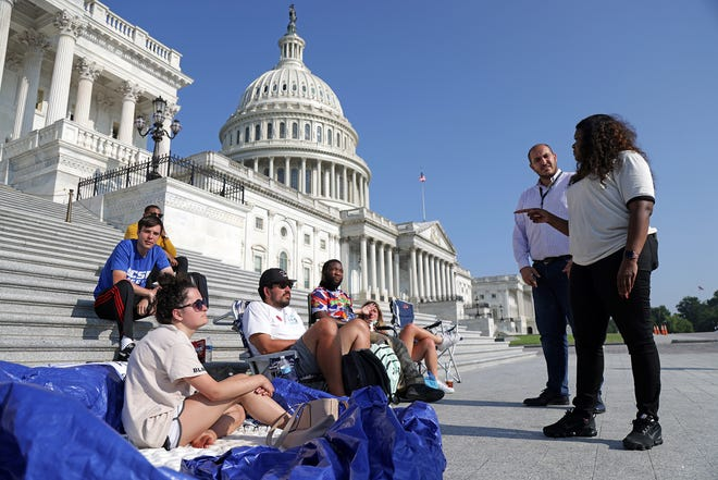 U.S. Cori Bush, right, talks to activists as they protest outside the U.S. Capitol on Aug. 2, 2021, in Washington, D.C. Bush, D-Mo., camped out at the front steps of the U.S. Capitol to protest the expiration of the eviction moratorium. (Alex Wong/Getty Images/TNS)