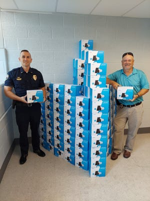 York City Police Lt. Dan Lentz, left, and Sgt. Blake McBride, right, show off the roughly 180 security cameras donated by Delaware-based Reolink for the city's Aging in Place program.