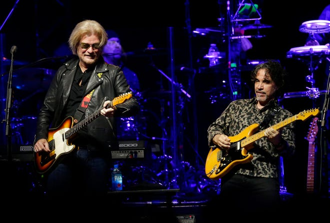 """FILE - Daryl Hall and John Oates perform in Glendale, Ariz. on July 17, 2017.  The multi-platinum duo behind hits like ″Private Eyes,"""" ″Rich Girl"""" and """"Maneater,"""" is ready to hit concert stages again. Their new tour kicks off Aug. 5 at Xfinity Center in Mansfield, Mass. (Photo by Rick Scuteri/Invision/AP, File)"""