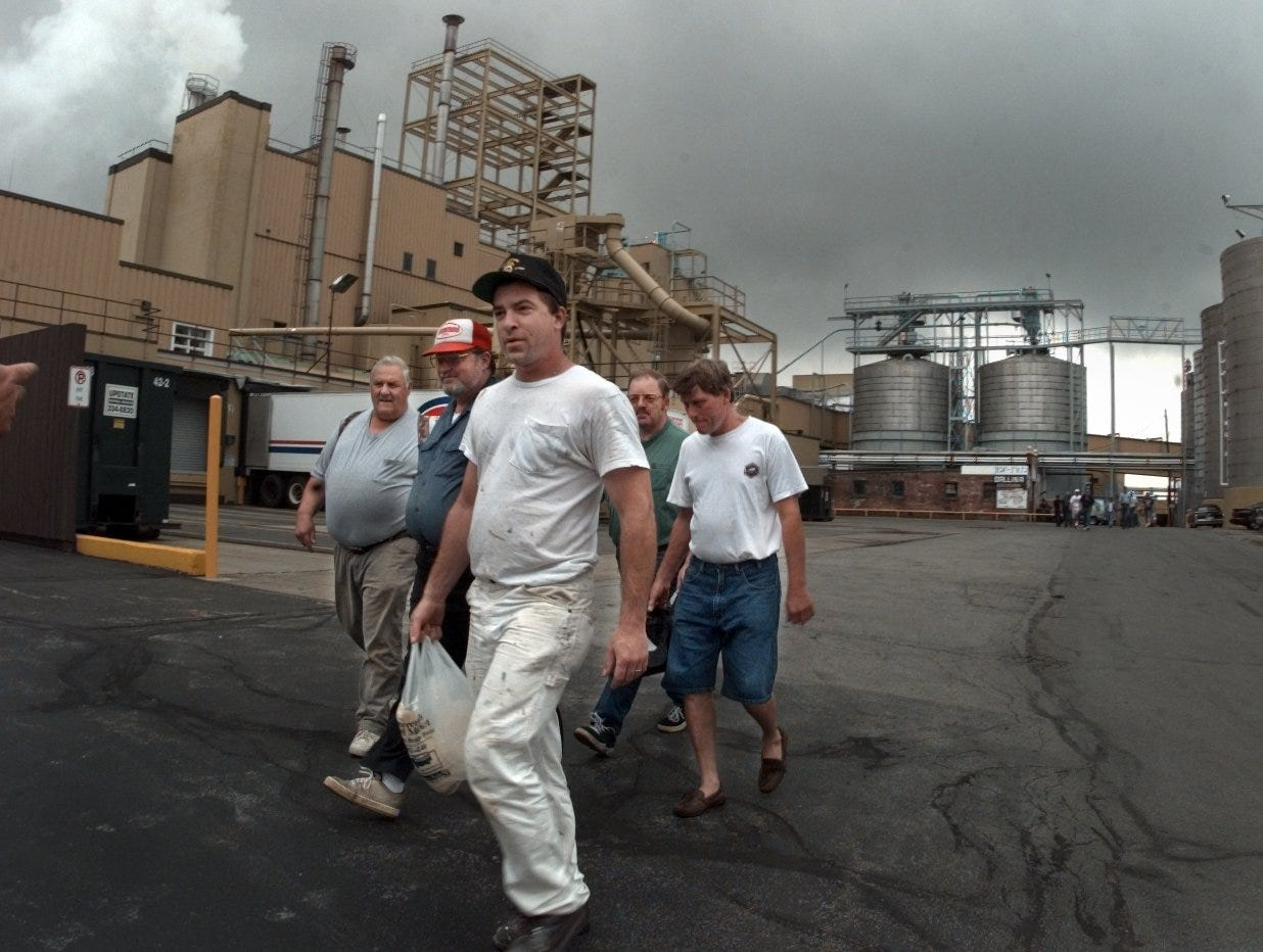 A group of Genesee Brewery workers leave the grounds on St. Paul Street after a 3:30 p.m. shift change Friday, Aug. 27, 1999. At the time, the future of the brewery looked uncertain because of stiff competition from Canadian brands and national beers.