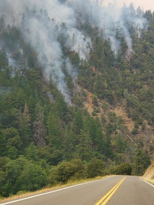 The Monument Fire burns in Trinity County in a photo posted by the Shasta-Trinity National Forest on Tuesday, Aug. 3, 2021.