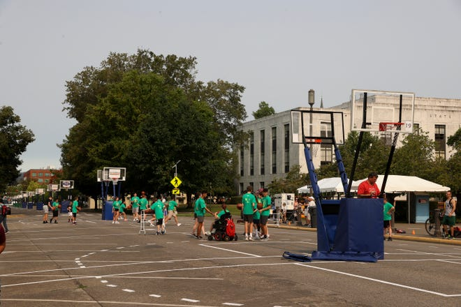 Students gather for a basketball clinic on Court Street NE as the streets around the Capitol have again been transformed for the Hoopla 3-on-3 basketball tournament.