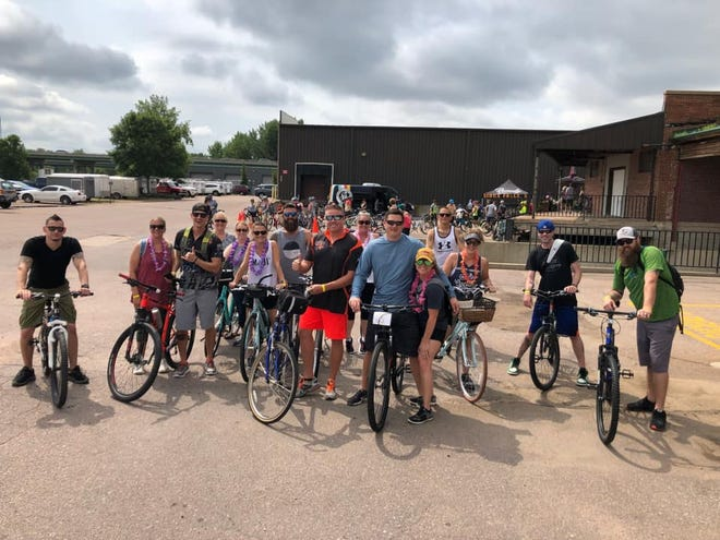 A group of bikers post during the Pedal FARR ride.
