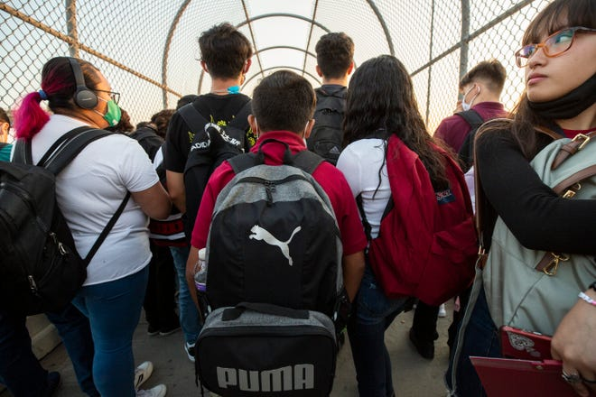 A six-grade student awaits with older students at the Ysleta-Zaragoza Bridge to enter the U.S. from Ciudad Juarez. Hundreds of students cross the international border between Ciudad Juarez and El Paso on a daily basis to attend schools.