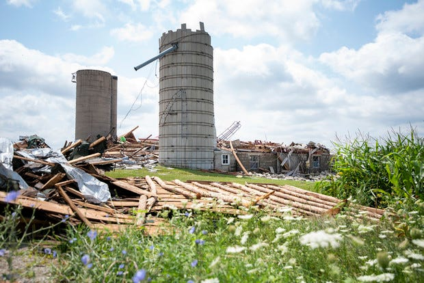A beam and peg barn that was built 125 years ago is in pieces after being damaged by a storm Thursday, July 29, 2021, in the Town of Concord.