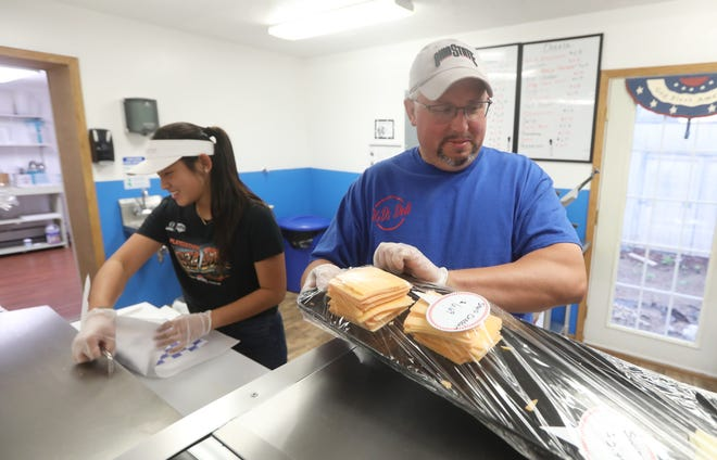 Damon Gibson and Anna Scheurman make a sub at D&D Deli in Dresden.