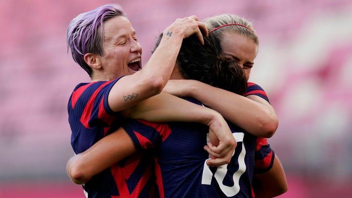 Megan Rapinoe, left, Carli Lloyd, center, and Lindsay Horan celebrate after Lloyd makes 3-1 vs. Australia on Thursday.