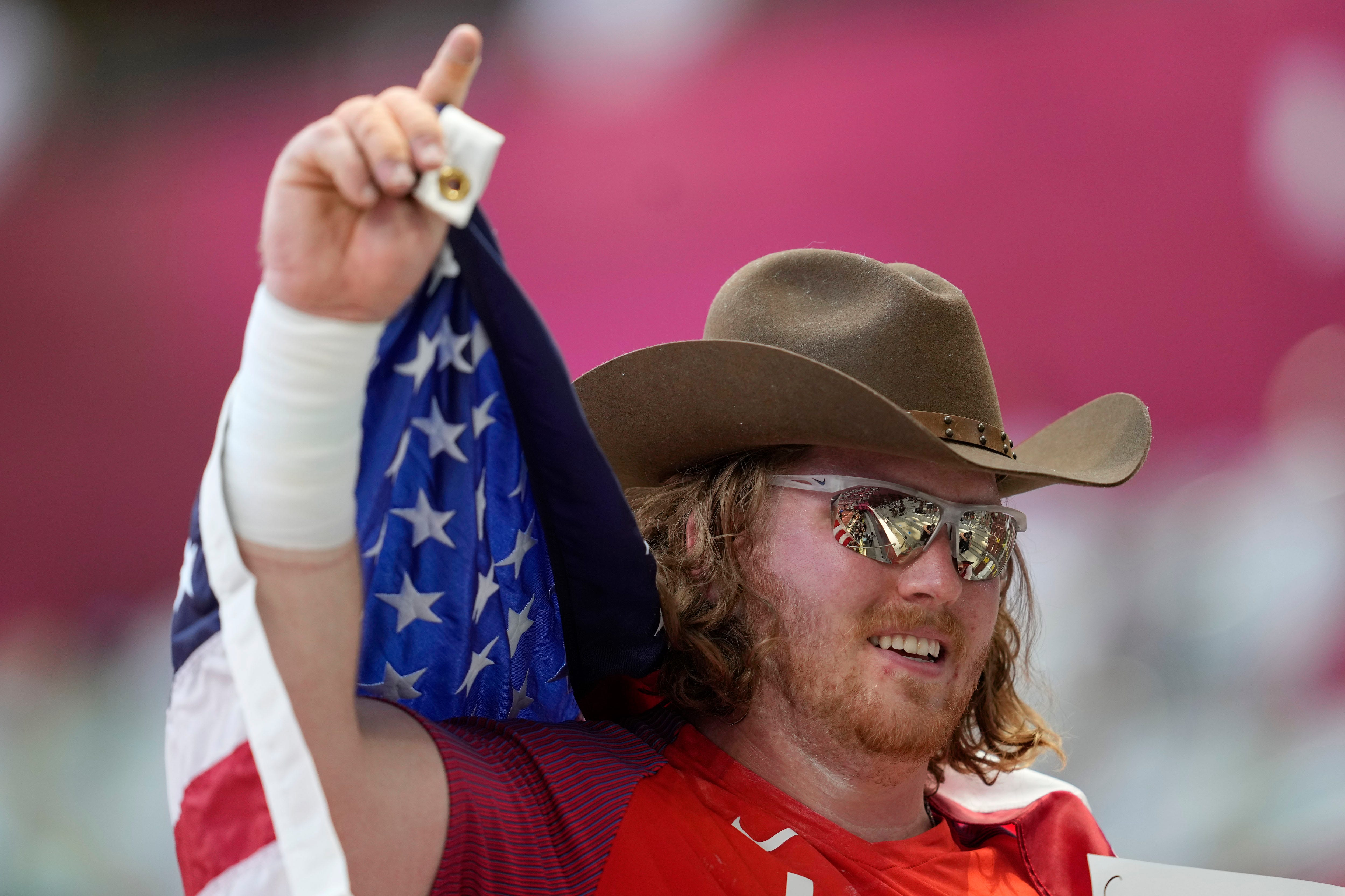 American Ryan Crouser sets Olympic shot put record three times to win gold; US takes silver, too