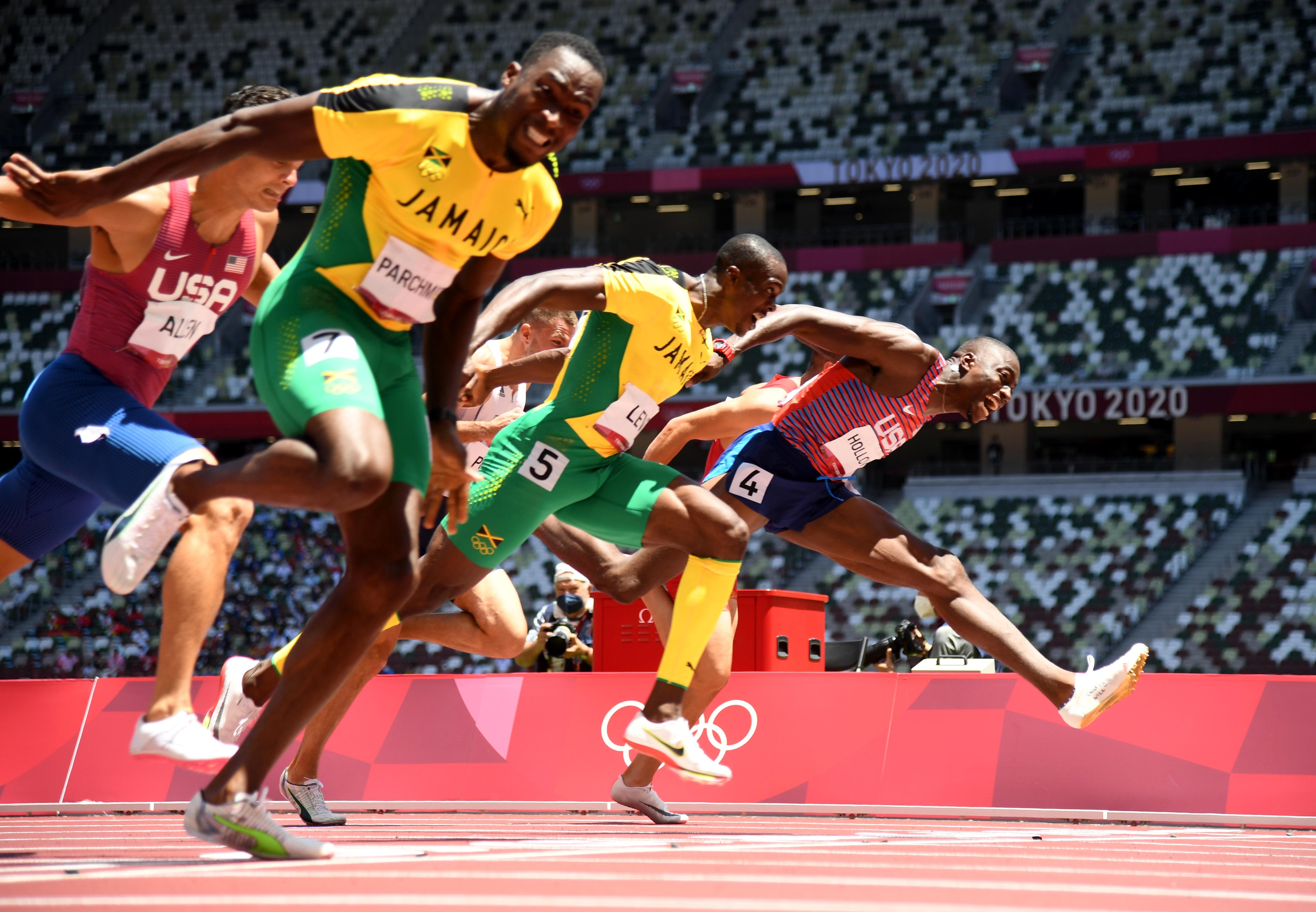 Tokyo Olympics live updates: Grant Holloway takes silver in 110m hurdles, US 4x100m relay team misses final