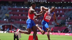 Fred Kerley, left, and Ronnie Baker exchange on the 4x100m relay during the Tokyo 2020 Olympic Games at Olympic Stadium.