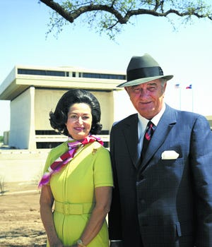 Lady Bird Johnson and President Lyndon B. Johnson pose in front of the new Lyndon B. Johnson Library on April 8, 1971. Lady Bird was instrumental in the planning and building of the LBJ Library, and now, 50 years later, her life is the focus of a new exhibit.