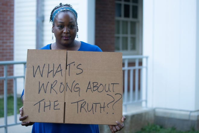 Stephanie Little Brown protests in June outside a public forum on critical race theory in Guilford, Connecticut.