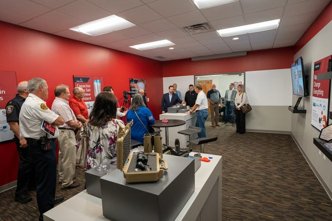 Staff at Peak Nano gave guests at the July 21 open house a tour of the new facility, which will serve as a foundry for optical lenses.