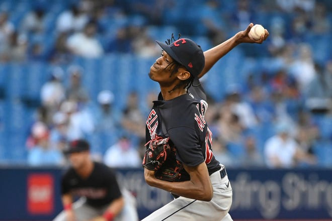 Cleveland starting pitcher Triston McKenzie throws to a Toronto Blue Jays batter during the first inning of a baseball game Thursday, Aug. 5, 2021, in Toronto. (Jon Blacker/The Canadian Press via AP)