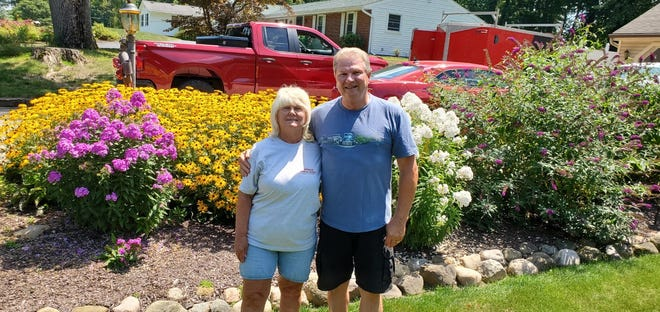 Donna and Mark Hupcy took first place for their garden in a gardening contest sponsored by Macedonia Professional Firefighters Local 3947.