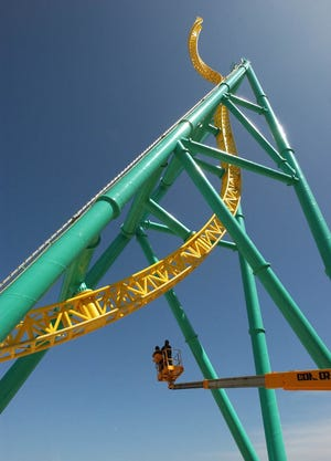 Workmen check out the Wicked Twister roller coaster at Cedar Point before it first opened. The park has announced that it is removing the ride.