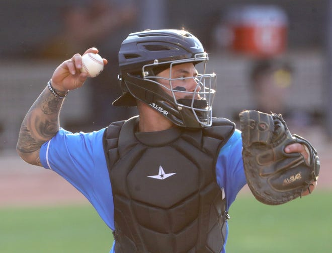 RubberDucks catcher Bryan Lavastida throws down to second between innings during a game against the Altoona Curve on Wednesday. [Phil Masturzo/Beacon Journal]