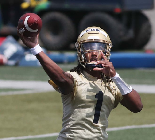 Kato Nelson, returning quarterback for the University of Akron football team, throws the ball during practice on the field at InfoCision Stadium. [Karen Schiely/Beacon Journal]
