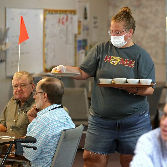 Jill Garst of Stow-Munroe Falls School District serves residents at Stow-Glen  Retirement Village on Friday.