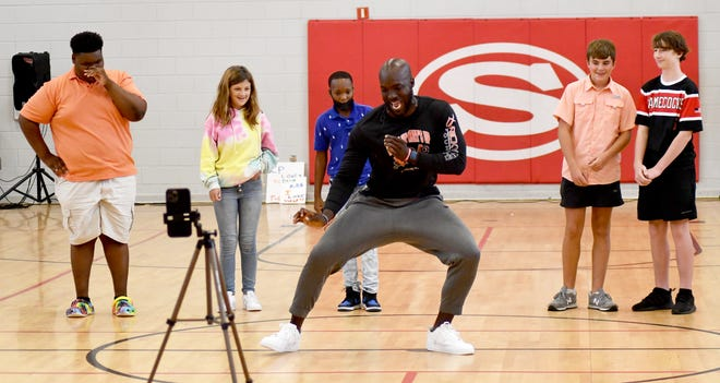 """Former NFL player Ricky Sapp visited Screven County Middle School on Aug. 3 to motivate students and staff to """"Dream Big Live Big."""" Sapp, who played high school football for Screven County Head Coach Ron Duncan when Duncan coached at Bamberg, S.C., was a Clemson standout. Here Sapp shows off some dance moves before SCMS students Jaylen Cail, Melanie Lee, Skyy Roberson, Brody Sturdivant and Todd Pitts get to display their dancing talents."""