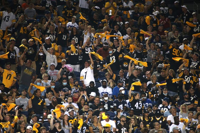 Pittsburgh Steelers fans wave the Terrible Towel after the Steelers gain a first down during the second half of the 2021 Hall Of Fame Game against the Dallas Cowboys Thursday night at Tom Benson Hall Of Fame Stadium in Canton, Ohio.
